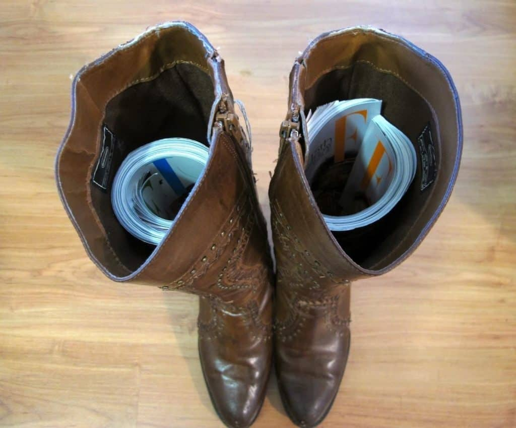 Try Inserting a Magazine or Newspaper inside the boots