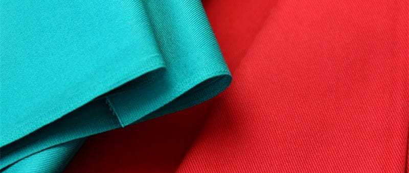 FR-treated cotton with fluorescent finish