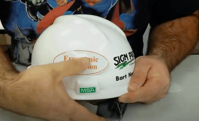 keep rubbing the sticker while placing it on the hard hat.