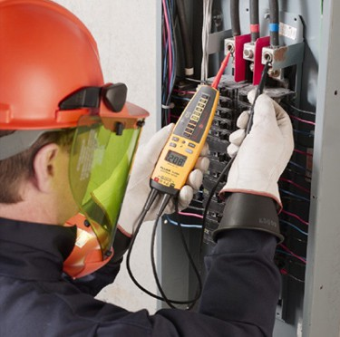 Why do electricians wear rubber gloves while working