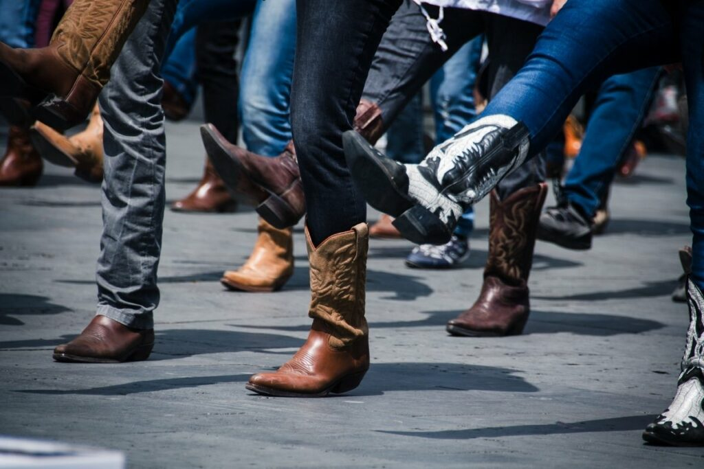 cowboy boots being slippery is that they were worn by the line dancers